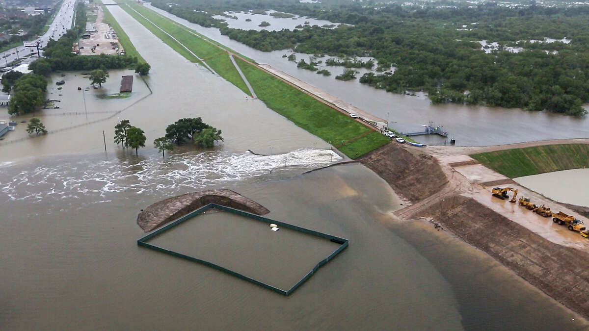 Water is released from the Barker Reservoir on Aug. 29 in the aftermath of Hurricane Harvey. Five days earlier, the U.S. Army Corps of Engineers had projected that the storm would fill the reservoir to record levels and would flood nearby neighborhoods.