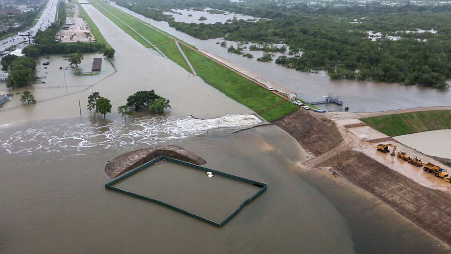 Water is released from the Barker Reservoir on Aug. 29 in the aftermath of Hurricane Harvey. Five days earlier, the U.S. Army Corps of Engineers had projected that the storm would fill the reservoir to record levels and would flood nearby neighborhoods. Photo: Brett Coomer, Staff / © 2017 Houston Chronicle