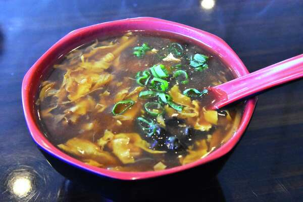 The hearty, piquant and vegetarian hot-and-sour soup is rich with vegetables, tofu and mushrooms. (Steve Barnes/Times Union.)