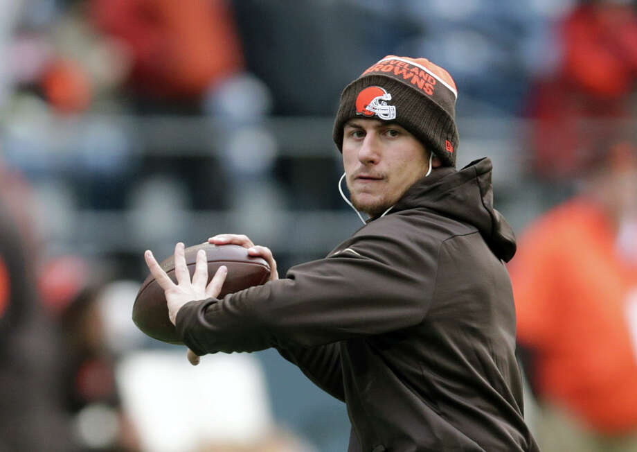 FILE - In this Dec. 20, 2015, file photo, Cleveland Browns quarterback Johnny Manziel warms-up before an NFL football game against the Seattle Seahawks, in Seattle. Former Heisman Trophy-winning quarterback Johnny Manziel says he's making a football comeback. Manziel announced Wednesday, Feb. 14, 2018,  that he will participate in the developmental Spring League in Austin, Texas, which will play from March 28 to April 15. The league is designed for players hoping to impress NFL scouts. The league confirmed Manziel will participate.  (AP Photo/Scott Eklund, File) Photo: Scott Eklund, FRE / FR171040 AP