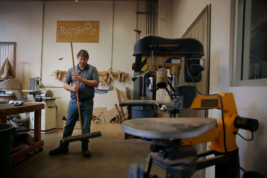 Kansas entrepreneur Dan Rasure, chief operating officer of TechShop 2.0, sweeps in the woodwork section of the company's building on Howard Street in South of Market as he prepares for Monday's opening of the second iteration of the maker space. Photo: Lea Suzuki, The Chronicle