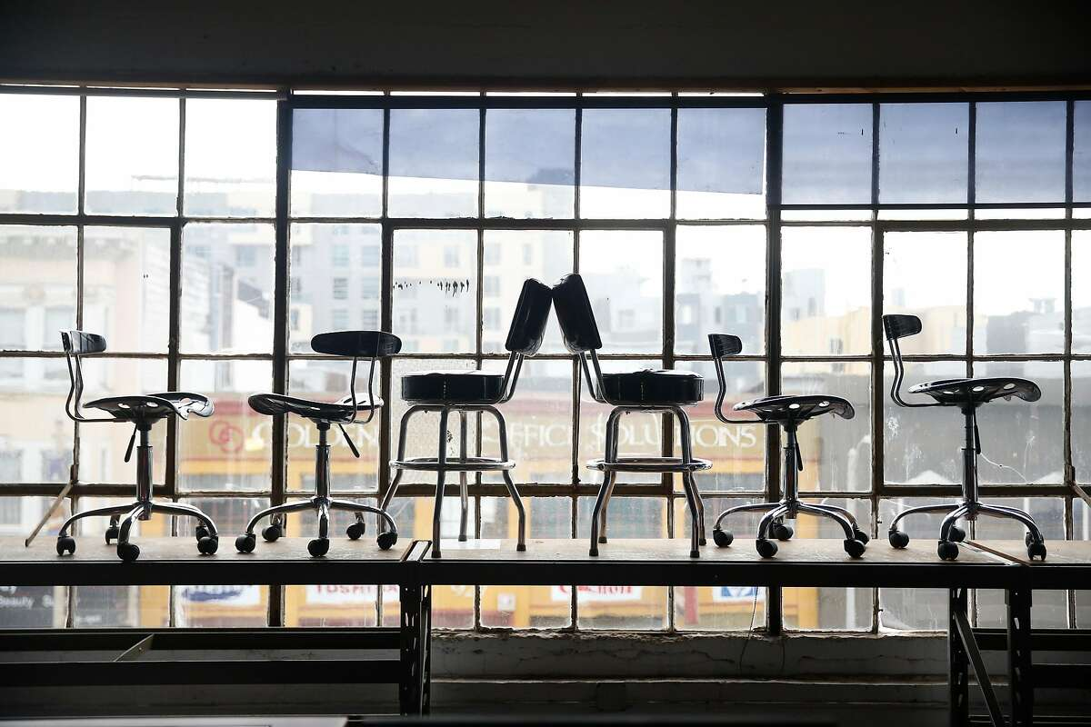 Chairs are stacked on a table in the workroom at the TechShop while it is prepared for the February 19 opening in San Francisco, Calif., on Wednesday, February 14, 2018.