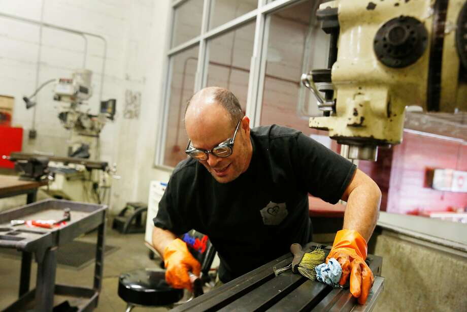 James Erd, machinist, artist, fabricator and longtime member, cleans a mill at the TechShop to help prepare for its Monday opening. Photo: Lea Suzuki, The Chronicle