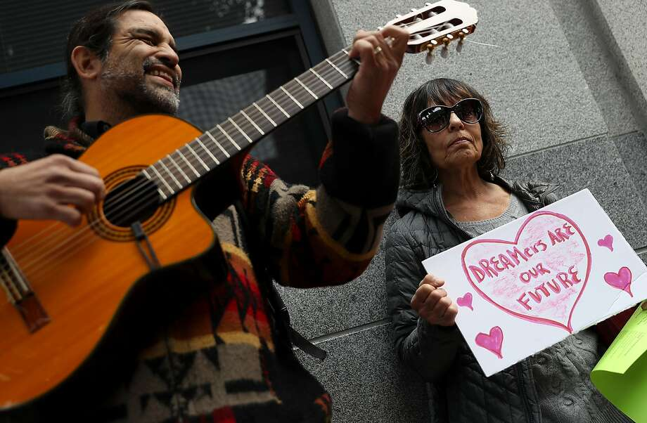 A demonstrator holds a homemade sign during a Valentine's Day demonstration outside of the San Francisco office of the Immigration and Cutsoms Enforcement. Dozens of immigration activists and faith leaders staged a Valentine's Day demonstration outside of the ICE offices in San Francisco to denounce detained immigrants and the lack of progress with DACA.  Photo: Justin Sullivan, Getty Images