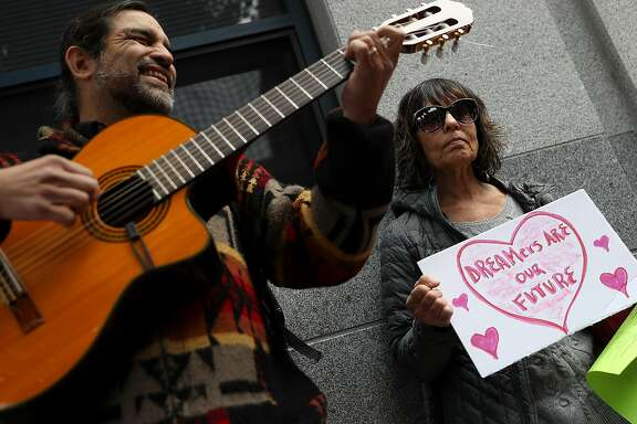 SAN FRANCISCO, CA - FEBRUARY 14:  A demonstrator holds a homemade sign during a Valentine's Day demonstration outside of the San Francisco office of the Immigration and Cutsoms Enforcement (ICE) on February 14, 2018 in San Francisco, California. Dozens of immigration activists and faith leaders staged a Vaentine's Day demonstration outside of the ICE offices in San Francisco to denounce detained immigrants and the lack of progress with DACA.  (Photo by Justin Sullivan/Getty Images)