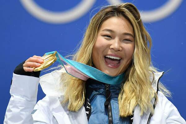 TOPSHOT - USA's gold medallist Chloe Kim poses on the podium during the medal ceremony for the snowboard women's Halfpipe at the Pyeongchang Medals Plaza during the Pyeongchang 2018 Winter Olympic Games in Pyeongchang on February 13, 2018. / AFP PHOTO / Kirill KUDRYAVTSEVKIRILL KUDRYAVTSEV/AFP/Getty Images