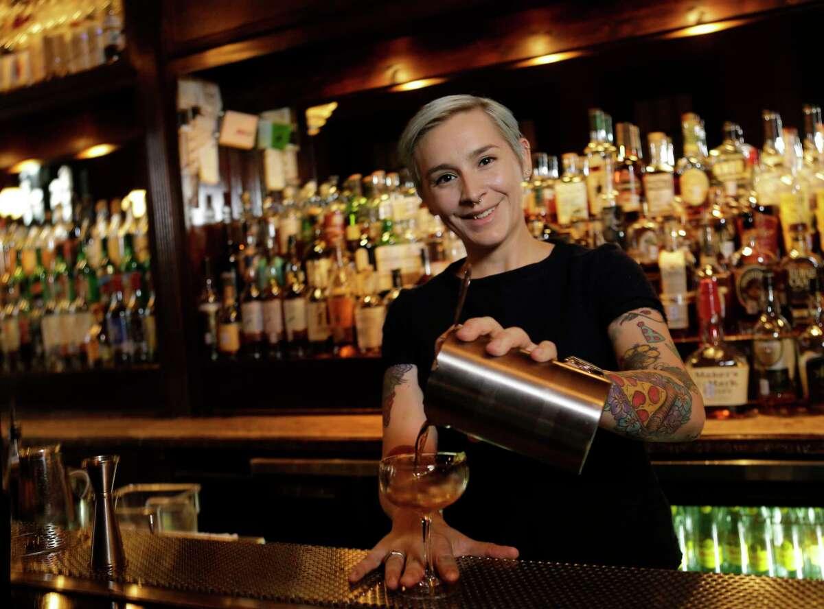 Bartender Lauren Sponberg is shown at Captain Foxheart's Bad News Bar, 308 S. Main, Tuesday, Feb. 6, 2018, in Houston. ( Melissa Phillip / Houston Chronicle ) \