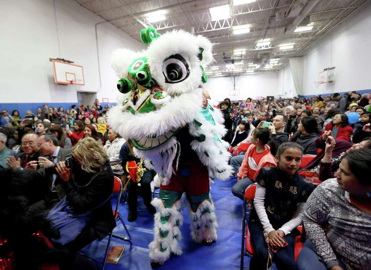 A lion dance, performed by members of Soaring Phoenix Dragon and Lion Dance Association, moves through the crowd at the Lunar New Year Festival at the Chinese Community Center Saturday, Feb. 6, 2016, in Houston. ( Jon Shapley / Houston Chronicle )