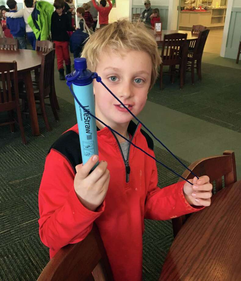 Teddy Kowalchick, third grader at Rumsey Hall School, holds up a LifeStraw, which filters unclean water to make it drinkable. Students raised enough to send three community LifeStraws to a school in Puerto Rico affected by the hurricane. Photo: Contributed Photo / Hearst Connecticut Media / The News-Times Contributed