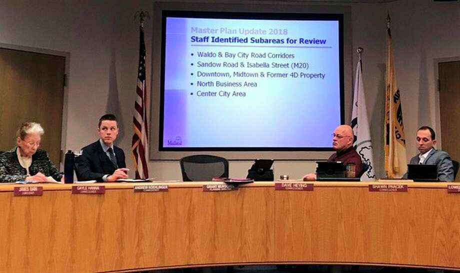 The Midland City Planning Commission votes in unanimous support of issuing an intent to plan, the first step in opening the city's master plan for review at a Tuesday meeting at City Hall. (Kate Carlson/kcarlson@mdn.net)