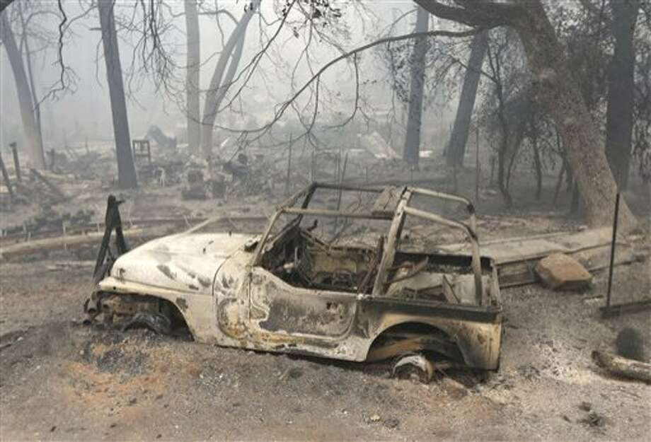 A vehicle destroyed by the Butte Fire sits on tireless rims in Mountain Ranch. Calaveras County officials plan to sue Pacific Gas and Electric Co. Photo: Rich Pedroncelli, AP