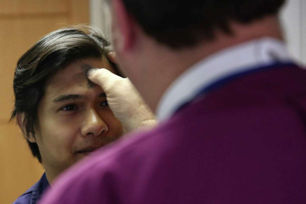 Episcopal Bishop Greg Rickel blesses a crew member of the APL Southhampton with ashes on Ash Wednesday, Feb. 14, 2018. Rickel and other members of the Seafarer's Club visited ships at ports in Seattle and Tacoma to bring ashes to the crews. Many Catholic crew members are from the Philippines, Malaysia, Russia, Poland, and other eastern European countries.