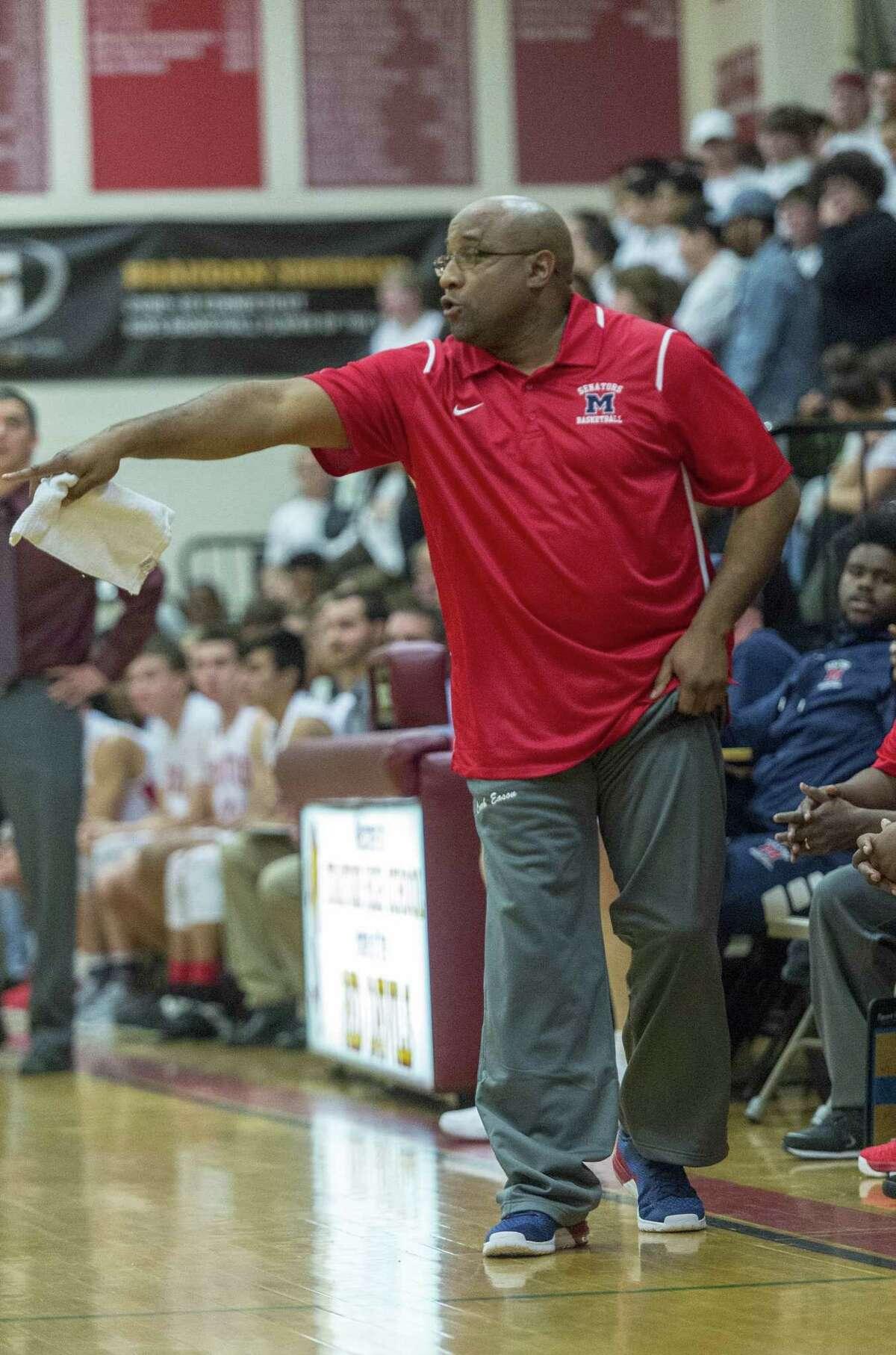 Brien McMahon High School head coach Darrick Eason gives his team instructions during a boys basketball game against Stratford High School played at Stratford High School, Stratford, CT. Thursday, December 21, 2017.