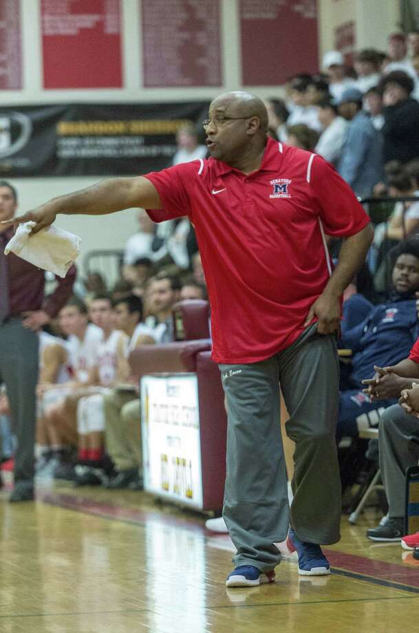 Brien McMahon High School head coach Darrick Eason gives his team instructions during a boys basketball game against Stratford High School played at Stratford High School, Stratford, CT. Thursday, December 21, 2017. Photo: Mark Conrad / For Hearst Connecticut Media / Connecticut Post Freelance