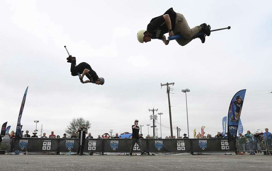 Biff Hutchison (left) and Michael Mena of the Extreme Pogo Stick stunt team (XPOGO) get airborne on their super-charged pogo sticks during a performance at the San Antonio Stockshow and Rodeo on Wednesday, Feb. 14, 2018. The four-man pogo team is a new act at the stockshow this year and combines comedy with athletic flair to woo audiences with their jumping abilities on pogo sticks. (Kin Man Hui/San Antonio Express-News) Photo: Kin Man Hui, Staff / San Antonio Express-News / ©2018 San Antonio Express-News