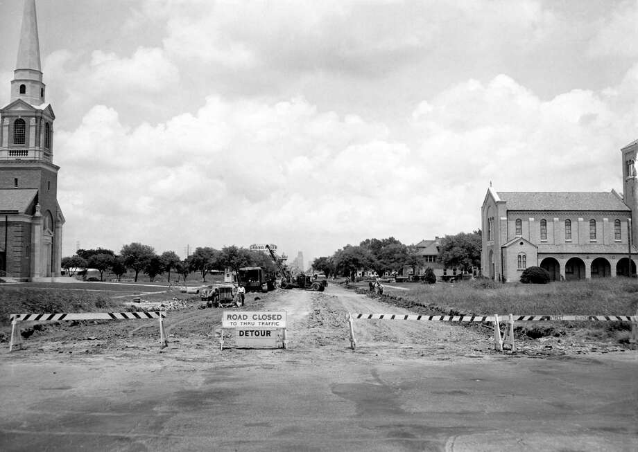 From the May 20, 1949, Chronicle: A country lane is what Main Street, looking north from Calumet, now resembles. Brown & Root Inc., is doing a $244,000 repaving job on Main, from Eagle to Sunken Garden. Concrete is being poured on the first section, from Eagle to Blodgett, and the section from Palm to Calumet is being readied for repaving. Weather permitting, the whole contract should be completed by the end of August, Houston city engineers say.First Presbyterian Church of Houston can be seen on the left andSt. Matthew Lutheran Church appears on the right. You can see how the area looks today here. Photo: Houston Chronicle / Houston Chronicle