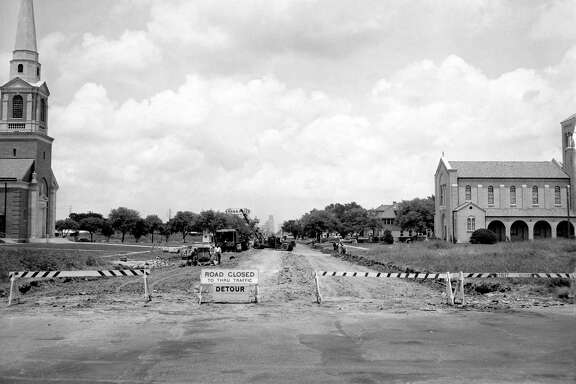 From the May 20, 1949, Chronicle: A country lane is what Main Street, looking north from Calumet, now resembles. Brown & Root Inc., is doing a $244,000 repaving job on Main, from Eagle to Sunken Garden. Concrete is being poured on the first section, from Eagle to Blodgett, and the section from Palm to Calumet is being readied for repaving. Weather permitting, the whole contract should be completed by the end of August, Houston city engineers say.   First Presbyterian Church of Houston can be seen on the left and St. Matthew Lutheran Church appears on the right. You can see how the area looks today  here .