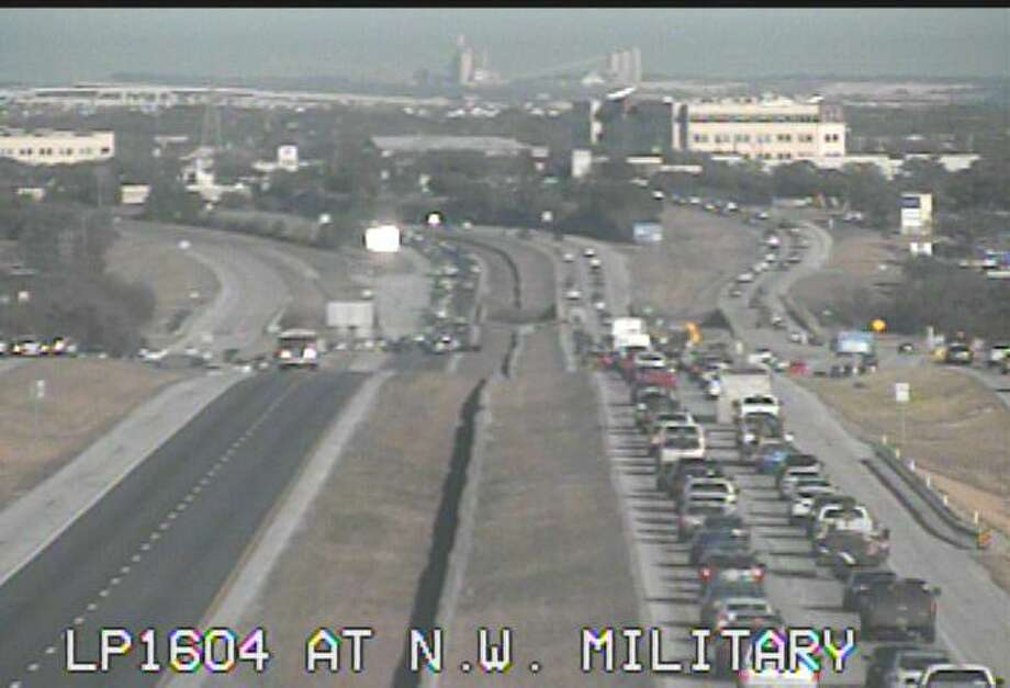 A major crash on the North Side Wednesday afternoon, Feb. 14, 2018, has closed down both of the westbound lanes of Loop 1604. The scene of the wreck can be seen in this image from the TxDOT camera looking east at N.W. Military Drive. Photo: TxDOT
