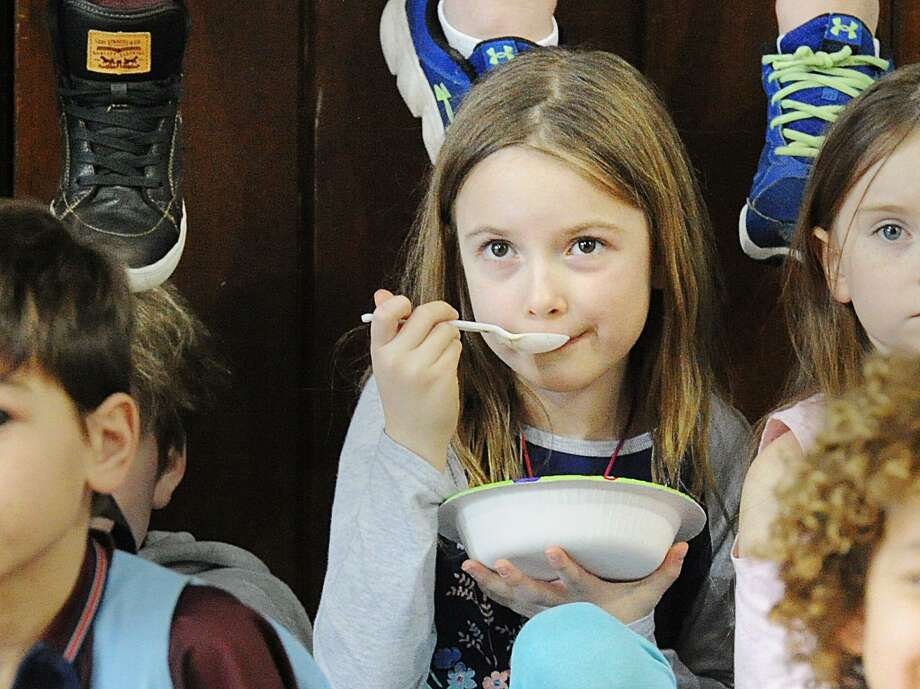 Boys & Girls Club of Greenwich Club member Charlotte Steidl, 7, enjoys a bowl of ice cream during the annual Ice Cream Social at the Boys & Girls Club of Greenwich at the club in Greenwich, Conn., Wednesday, Feb. 14, 2018. Rebecca Breed, a long time board member at the club has provided the ice cream and trappings for the event for the past 10 years in honor of St. Valentine's Day. Takeia McAllister the public relations director for the club said 175 club members were served ice cream during the event. Photo: Bob Luckey Jr. / Hearst Connecticut Media / Greenwich Time