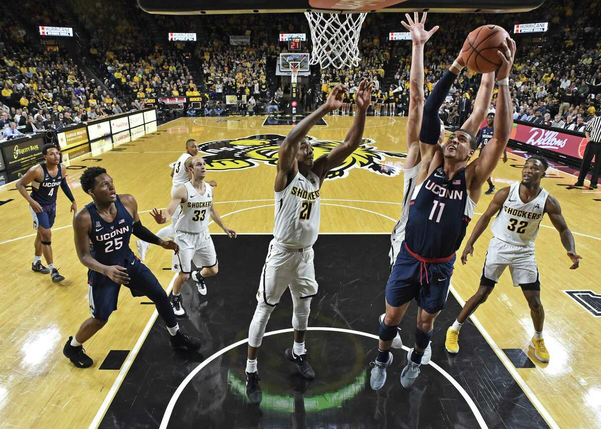 UConn's Kwintin Williams drives to the basket against Wichita State's Darral Willis Jr. during Saturday's contest.