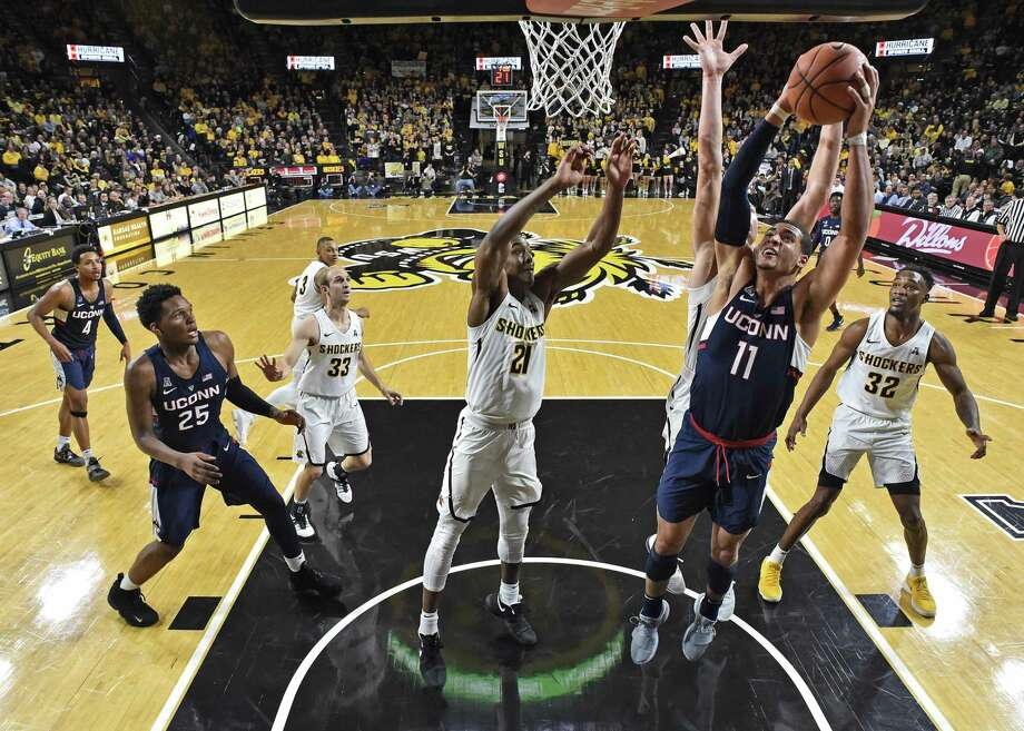 UConn's Kwintin Williams drives to the basket against Wichita State's Darral Willis Jr. during Saturday's contest. Photo: Peter Aiken / Getty Images / 2018 Getty Images