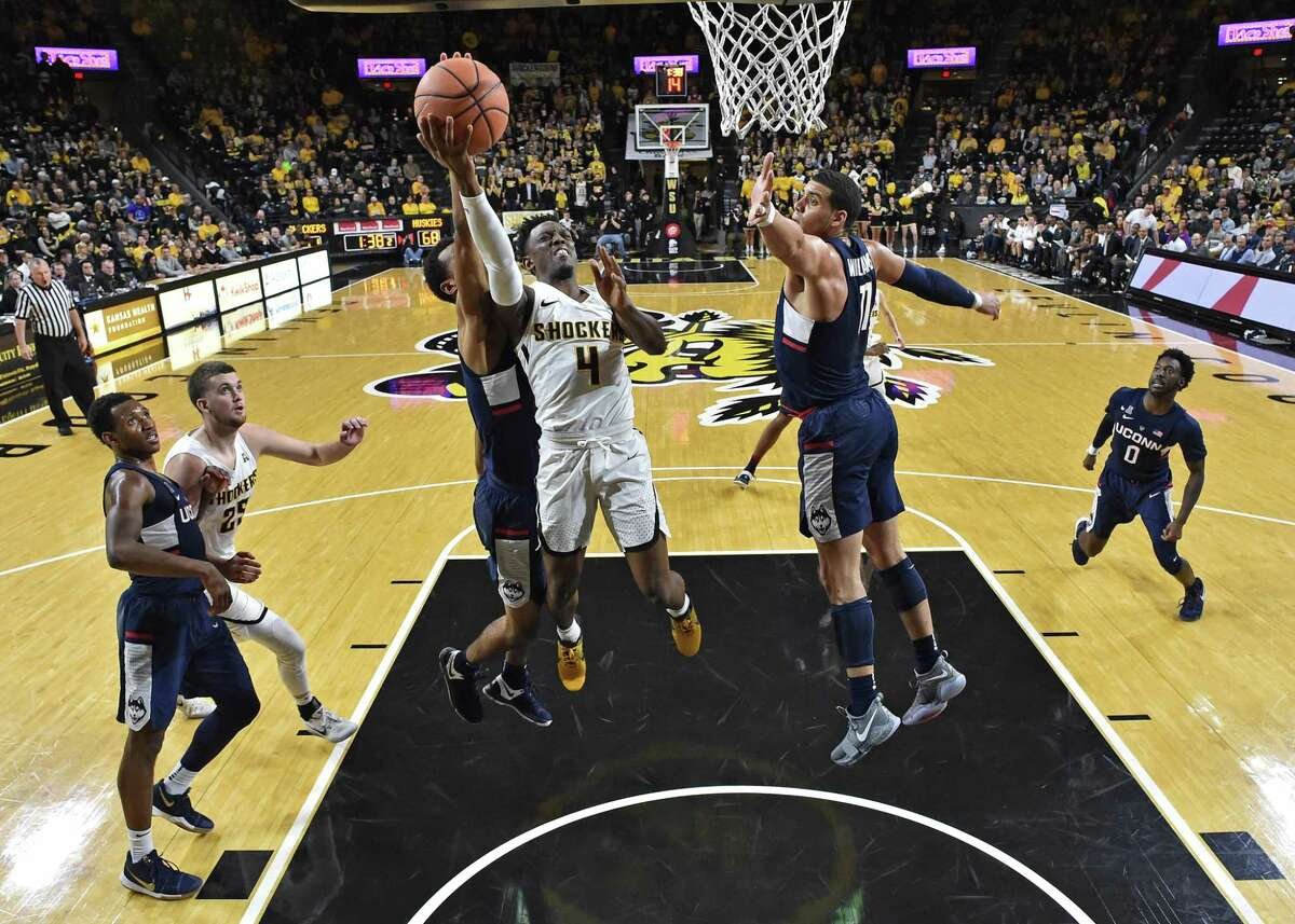 Wichita State's Samajae Haynes-Jones drives to the basket against UConn's Kwintin Williams during the second half of Saturday's game.