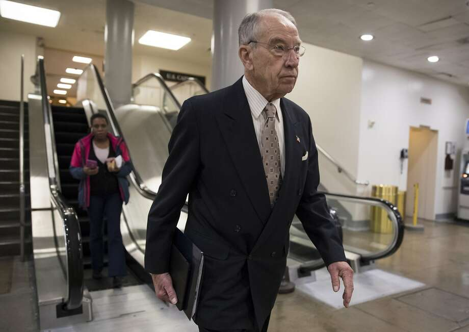 Senate Judiciary Committee Chairman Chuck Grassley, R-Iowa, walks through a basement passageway at the Capitol amid debates in the Senate on immigration. President Donald Trump is thanking Grassley for introducing legislation similar to the immigration framework pushed by the White House.  Photo: J. Scott Applewhite, Associated Press
