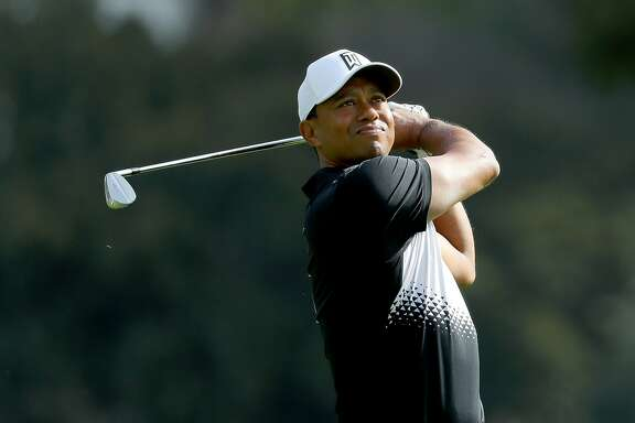 PACIFIC PALISADES, CA - FEBRUARY 14:  Tiger Woods hits a shot during the Pro-Am of the Genesis Open at the Riviera Country Club on February 14, 2018 in Pacific Palisades, California.  (Photo by Warren Little/Getty Images)