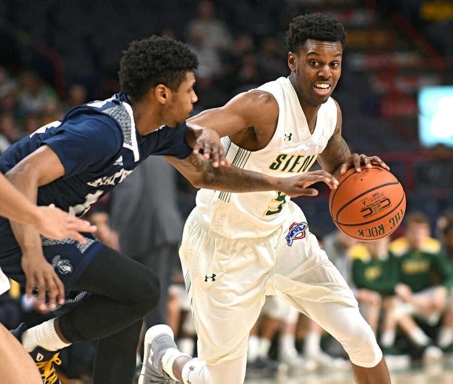 "Siena redshirt junior guard Kadeem Smithen, shown against Saint Peter's, said the Saints have ""great confidence"" after beating Iona on Monday. (Lori Van Buren/Times Union)"