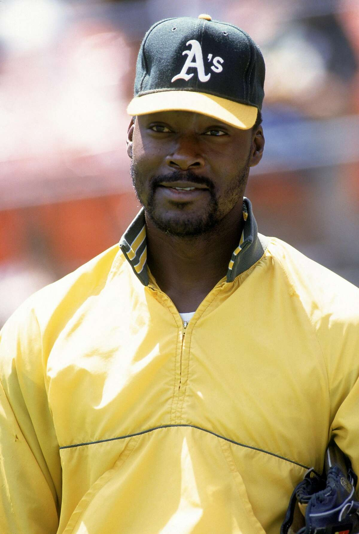 OAKLAND - 1990: Pitcher Dave Stewart #34 of the Oakland Athletics stand on the field before a game during the 1990 season at Oakland Alameda County Stadium in Oakland, California. (Photo by Otto Greule Jr/Getty Images)