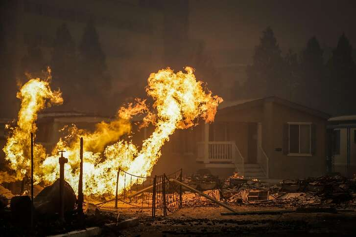 The Journey's End mobile home park burns during a the Tubbs fire on Mendocino Avenue in Santa Rosa, Calif., on Monday, Oct. 9, 2017.
