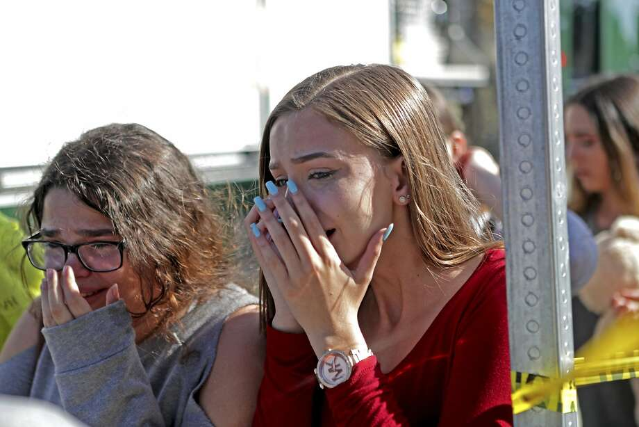 Students released after the school lockdown in at Parkland, Fla. Photo: John McCall, Associated Press