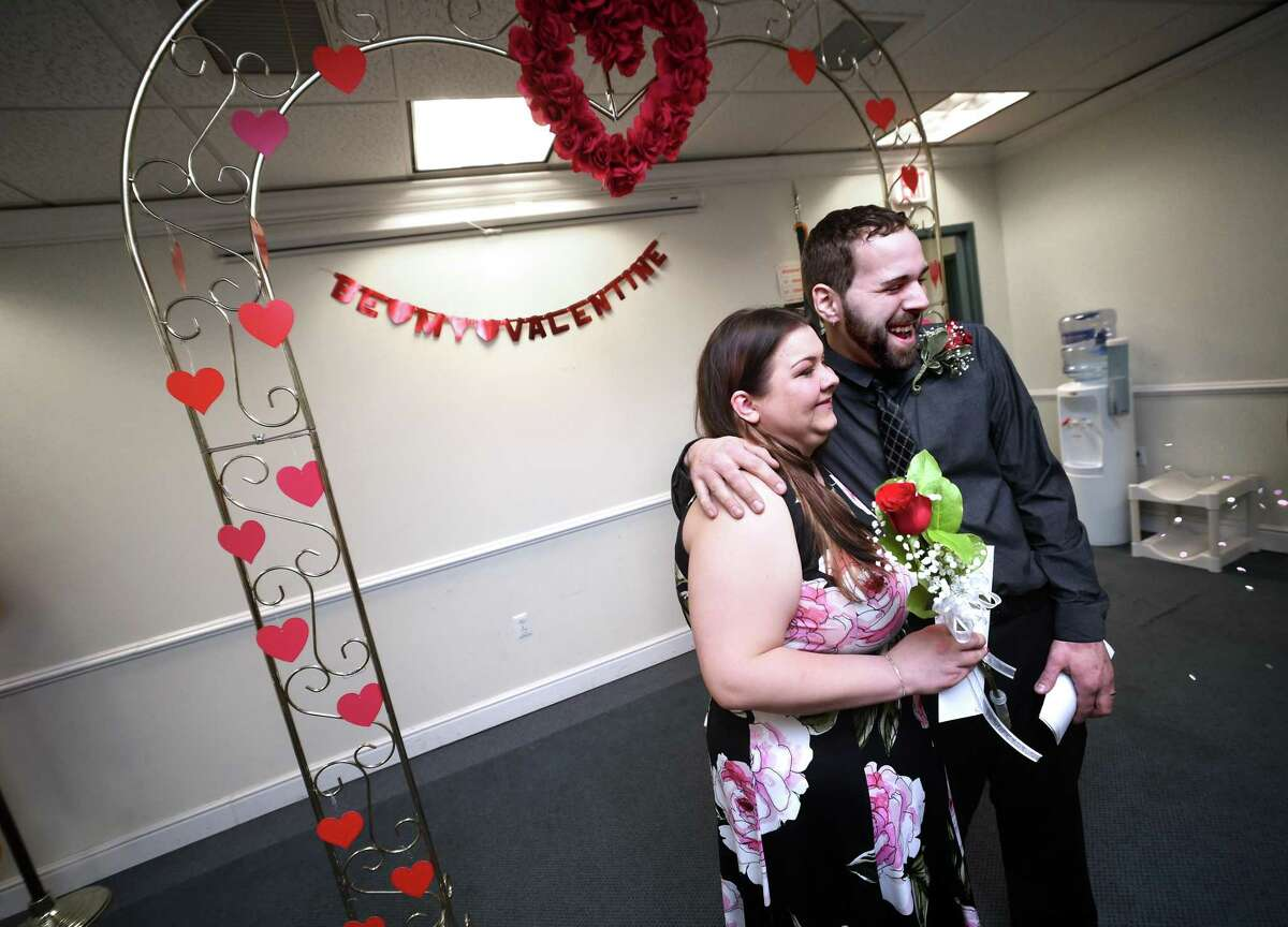 Jessica Vespoli and William Leonardo pose for photographs after being married at the Hamden Government Center Wednesday.