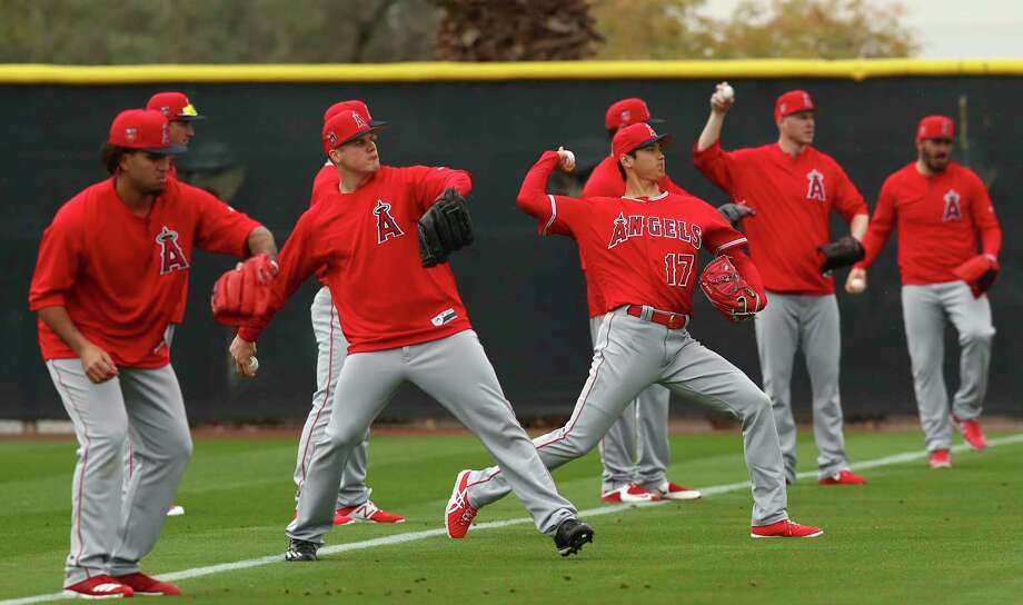 Los Angeles Angels' Shohei Ohtani (17) throws alongside other pitchers during a spring training baseball practice on Wednesday, Feb. 14, 2018, in Tempe, Ariz. (AP Photo/Ben Margot) Photo: Ben Margot, Associated Press / Copyright 2018 The Associated Press. All rights reserved.
