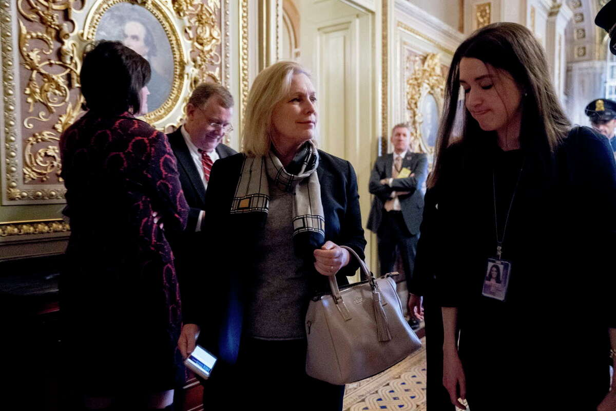 Sen. Kirsten Gillibrand, D-N.Y., center, leaves a Democratic policy luncheon on Capitol Hill in Washington, Tuesday, Feb. 13, 2018. (AP Photo/Andrew Harnik)