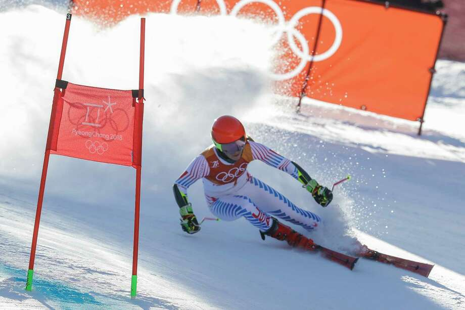 Mikaela Shiffrin, of the United States, attacks the gate during the first run of the Women's Giant Slalom at the 2018 Winter Olympics in Pyeongchang, South Korea, Thursday, Feb. 15, 2018., Thursday, Feb. 15, 2018. Photo: Michael Probst, AP / Copyright 2018 The Associated Press. All rights reserved