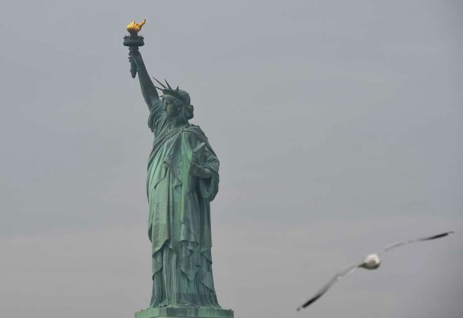 The Statue of Liberty is seen after the re-opening, Jan. 22, 2018 in New York. (AFP/Getty Images) Photo: TIMOTHY A. CLARY, Contributor / AFP or licensors