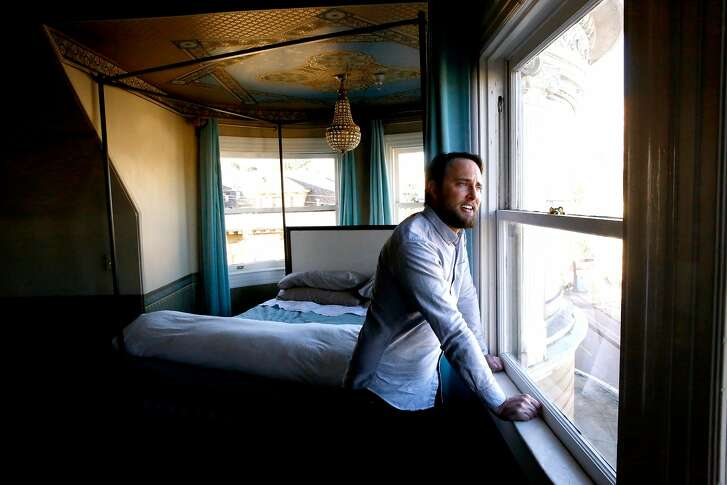 Ryan Booth in his living room he turned into his bedroom in San Francisco, Calif., on Monday Feb. 5, 2018.  Booth is able to afford his San Francisco flat  by renting out his bedroom down the hall through Airbnb.