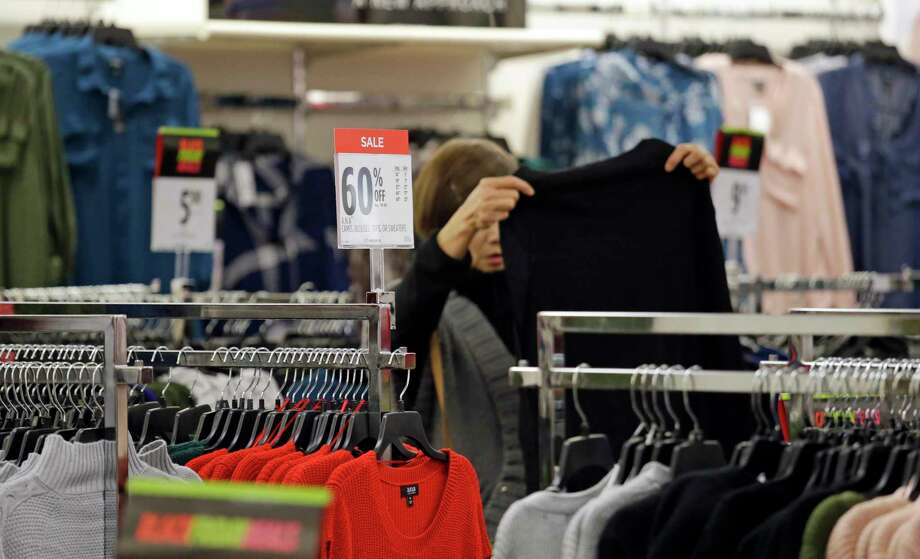 FILE- In this Nov. 24, 2017, file photo, a shopper looks over clothing at a J.C. Penney store in Seattle. On Wednesday, Feb. 14, 2018, the Labor Department reports on U.S. consumer prices for January. (AP Photo/Elaine Thompson, File) Photo: Elaine Thompson, STF / Copyright 2017 The Associated Press. All rights reserved.