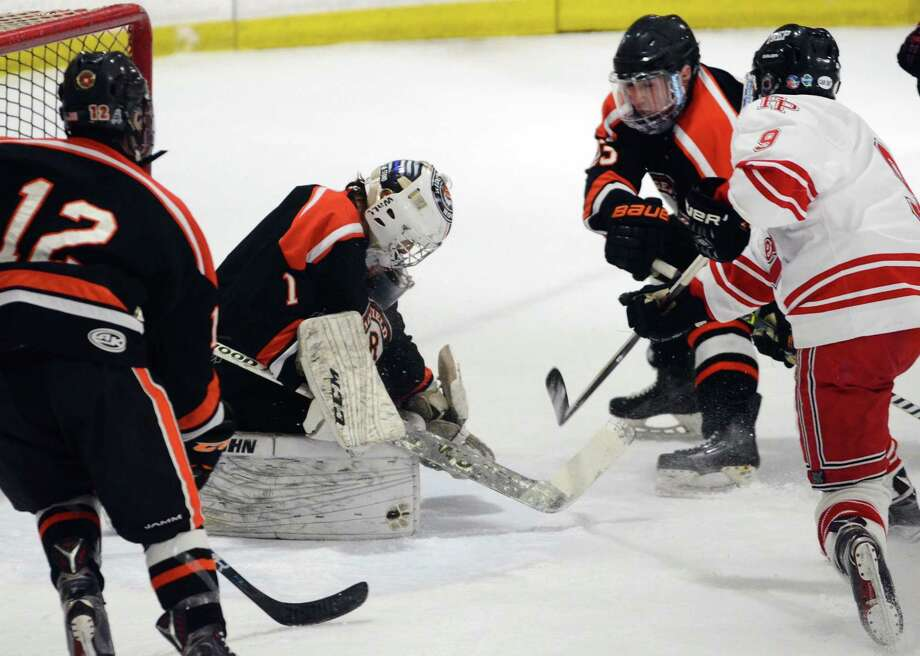 Ridgefield goalie Sean Gordon tries to block a shot by Fairfield Prep's Carter Kral during boys hockey action at the Wonderland of Ice in Bridgeport, Conn., on Wednesday Feb. 14, 2018. Kral got the puck past to score. Photo: Christian Abraham / Hearst Connecticut Media / Connecticut Post