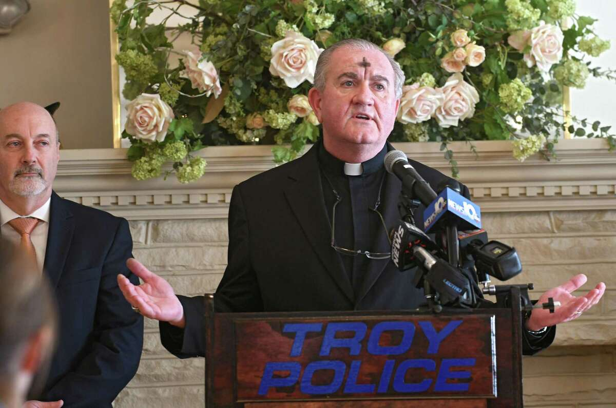 Rev. Officer Paul Carney delivers the benediction before Troy Mayor Patrick Madden swears in Troy's assistant police chief Daniel DeWolf and chief Brian Owens at Franklin Terrace on Wednesday, Feb. 14, 2018 in Troy, N.Y. (Lori Van Buren/Times Union)