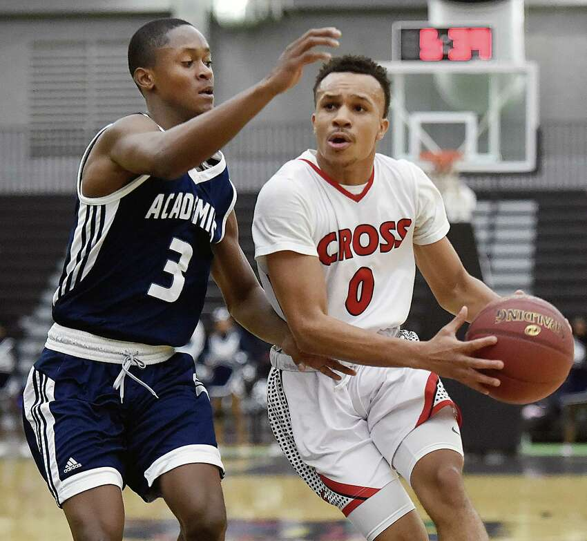 Wilbur Cross guard Kwane Taylor penetrates the paint as Hillhouse Davon Warner defends in a cross-town rival game, Wednesday, Feb. 14, 2018, at the Floyd Little Athletic Center in New Haven. The Governors beat the Academics, 65-50.