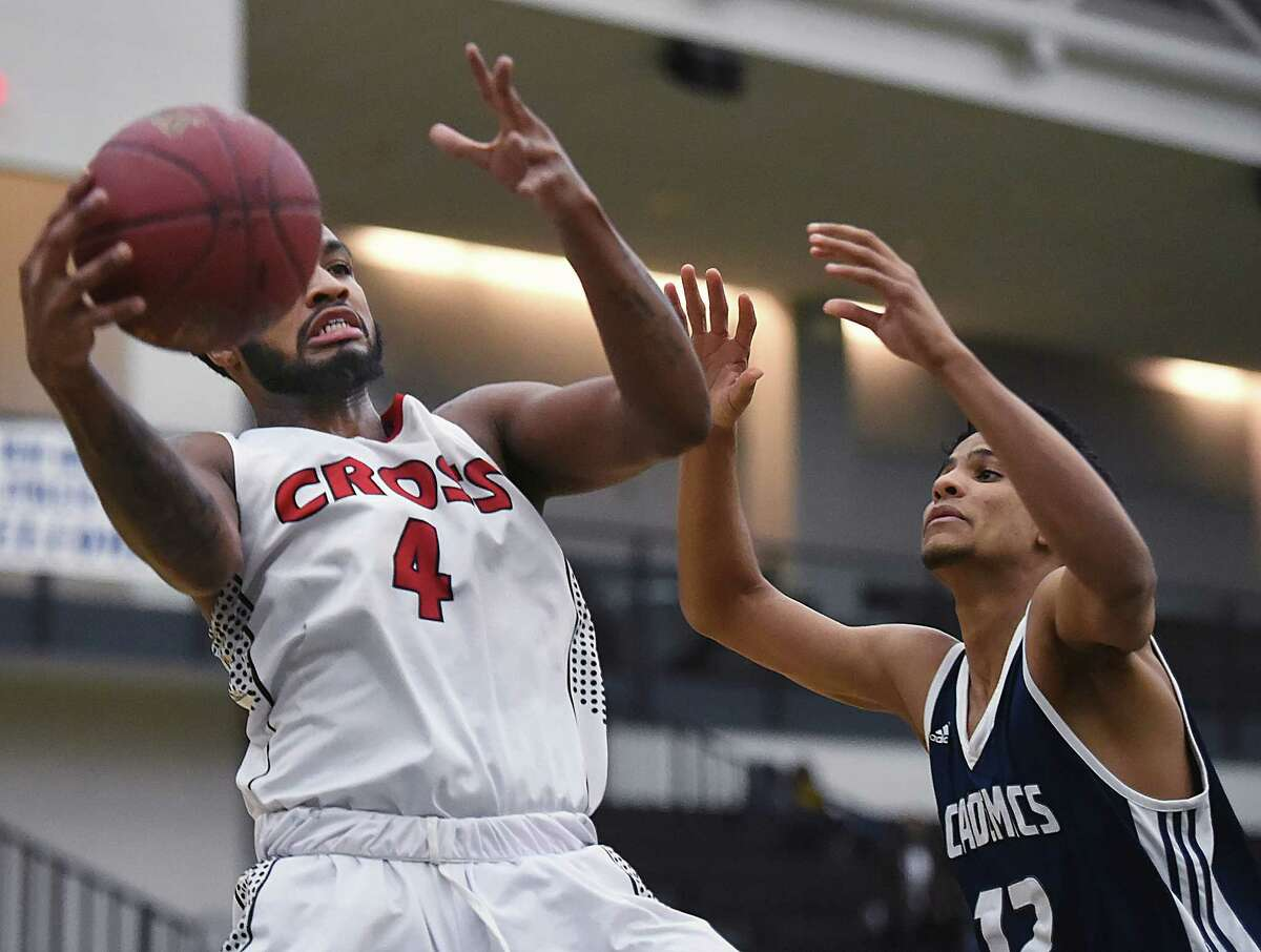 Wilbur Cross' Jaykeen Foreman grabs a rebound against Dalgoris Flete of Hillhouse in a cross-town rival game, Wednesday, Feb. 14, 2018, at the Floyd Little Athletic Center in New Haven. Wilbur Cross won, 65-50.