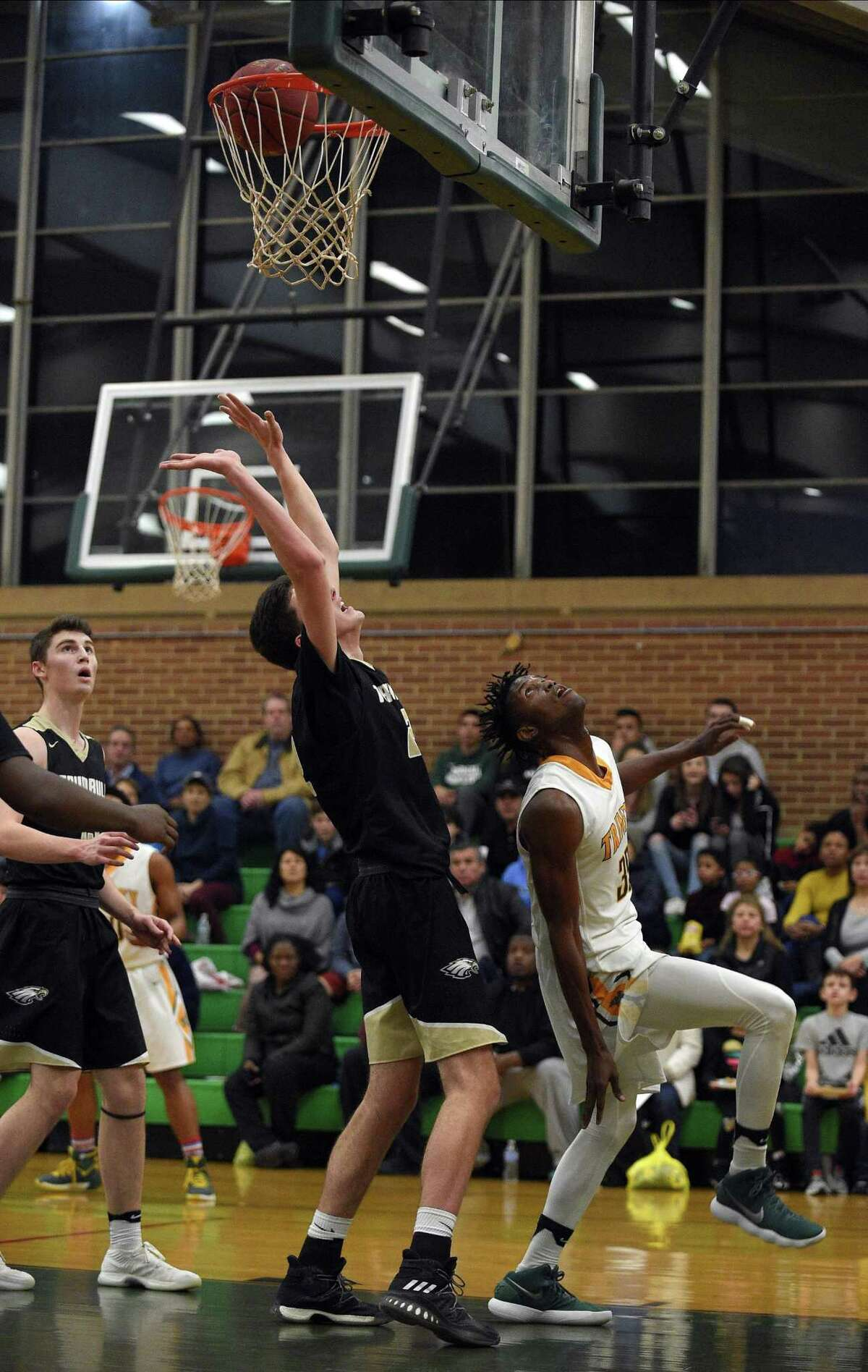 Trinity Catholic's Dimitry Moise (35) watches as his 1,000th carreer point basket fall through the hoop during an FCIAC Boys Basketball game against Trumbull at Trinity Catholic High School on Wednesday, Feb. 14, 2018 in Stamford, Connecticut. Fellow teammate Contavio Dutreil also scored his 1,000th career point.