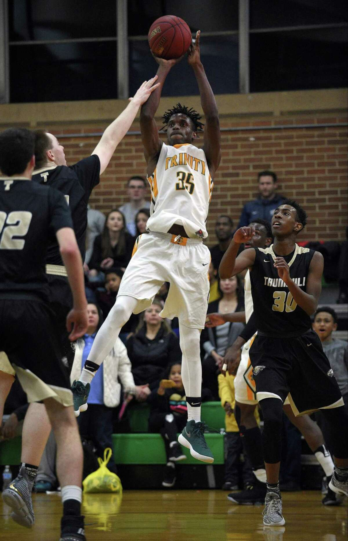 Trinity Catholic's Dimitry Moise (35) puts up a shot during an FCIAC Boys Basketball game against Trumbull at Trinity Catholic High School on Wednesday, Feb. 14, 2018 in Stamford, Connecticut. Moise and fellow teammate Contavio Dutreil both scored their 1,000th game point of their high school careers.