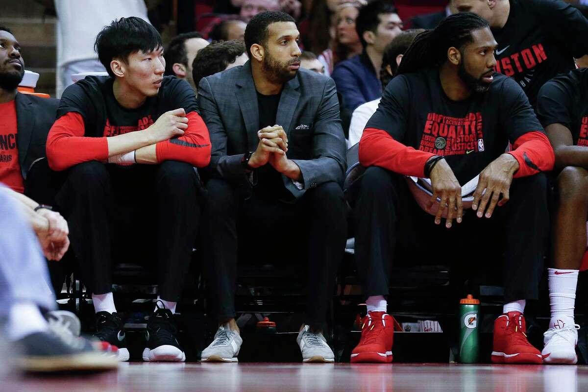 Houston Rockets forward Brandan Wright (32), center, sits on the bench as the Houston Rockets take on the Sacramento Kings at the Toyota Center Wednesday, Feb. 14, 2018 in Houston.