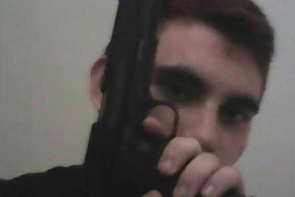 The suspect arrested in connection with Wednesday's shooting at a Florida high school, which left at least 17 people dead, was identified by the sheriff as 19-year-old Nikolas Cruz. He is shown here with an air gun.