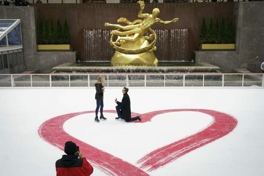NEW YORK, NY - FEBRUARY 14: Jacob Cox (R) proposes to Cierra Sorrells on Valentine's Day at Rockefeller Center Ice Rink, February 14, 2018 in New York City. Sorrells said yes. The couple is from Greenville, South Carolina. (Photo by Drew Angerer/Getty Images) *** BESTPIX *** Photo: Drew Angerer / 2018 Getty Images