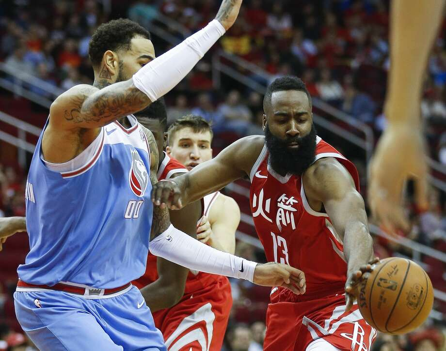 Houston Rockets guard James Harden (13) passes the ball away from a defending Sacramento Kings center Willie Cauley-Stein (00) as the Houston Rockets take on the Sacramento Kings at the Toyota Center Wednesday, Feb. 14, 2018 in Houston. (Michael Ciaglo / Houston Chronicle) Photo: Michael Ciaglo/Houston Chronicle