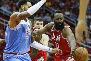 Houston Rockets guard James Harden (13) passes the ball away from a defending Sacramento Kings center Willie Cauley-Stein (00) as the Houston Rockets take on the Sacramento Kings at the Toyota Center Wednesday, Feb. 14, 2018 in Houston. (Michael Ciaglo / Houston Chronicle)